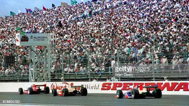 The green flag waves to start the Indy 200 Indy Racing League IRL race at Walt Disney World Speedway Speedway on January 27 1996 in Orlando FL