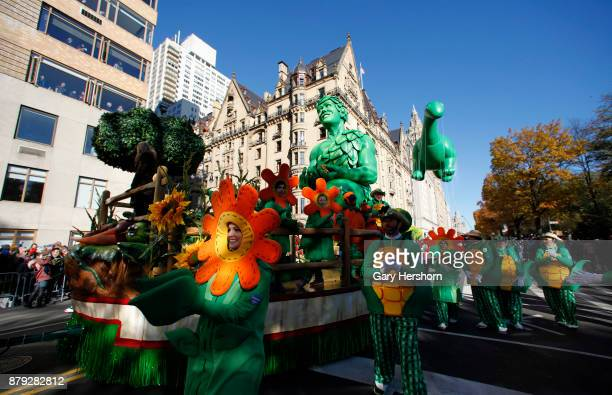 The Green Giant float and Sinclair's Dino balloon proceed down Central Park West during the annual Thanksgiving Day Parade on November 23 2017 in New...