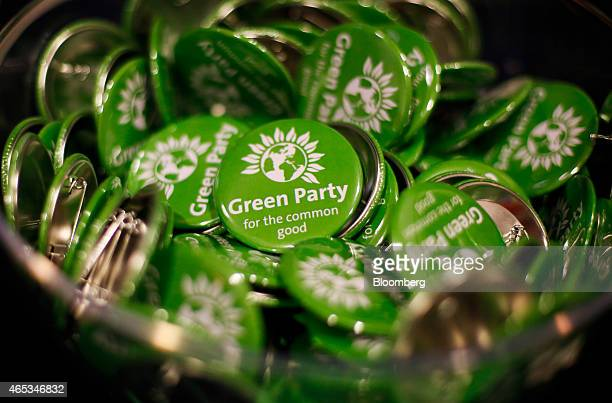 The Green Party logo sits on campaign badges during the party's spring conference in Liverpool UK on Friday March 6 2015 Green Party leader Natalie...