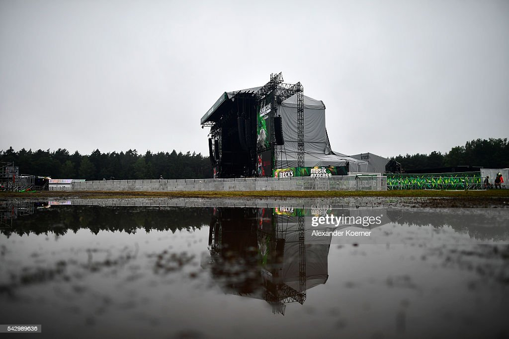 The Green Stage is reflected in a puddle at the Hurricane Festival compound on June 25, 2016 in Scheessel, Germany. The Hurricane Festival was evacuated yesterday and is delayed today for the late evening, following heavy rain and thunderstorm alerts. The rain and thunderstorm have hit the festival during the night and day, causing damage to tents and flooded the festival site, only 7 concerts can be played on two stages today. The Hurricane Festival celebrates this year its 25th anniversary. 75.000 music fans have visited the Festival, but some thousands have already left the compound due to the current situation.