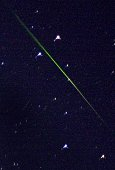 The green streak of a meteor seen in the southern sky of New England photographed in Sherborn Massachusetts early 18 November 2001 and was one of...