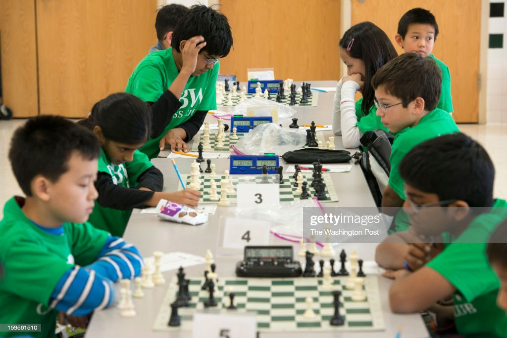 The Greenbrier West Elementary School chess team gathers in the school cafeteria to play against each other at Greenbriar West Elementary School in Chantilly, Virginia on January 07, 2013.