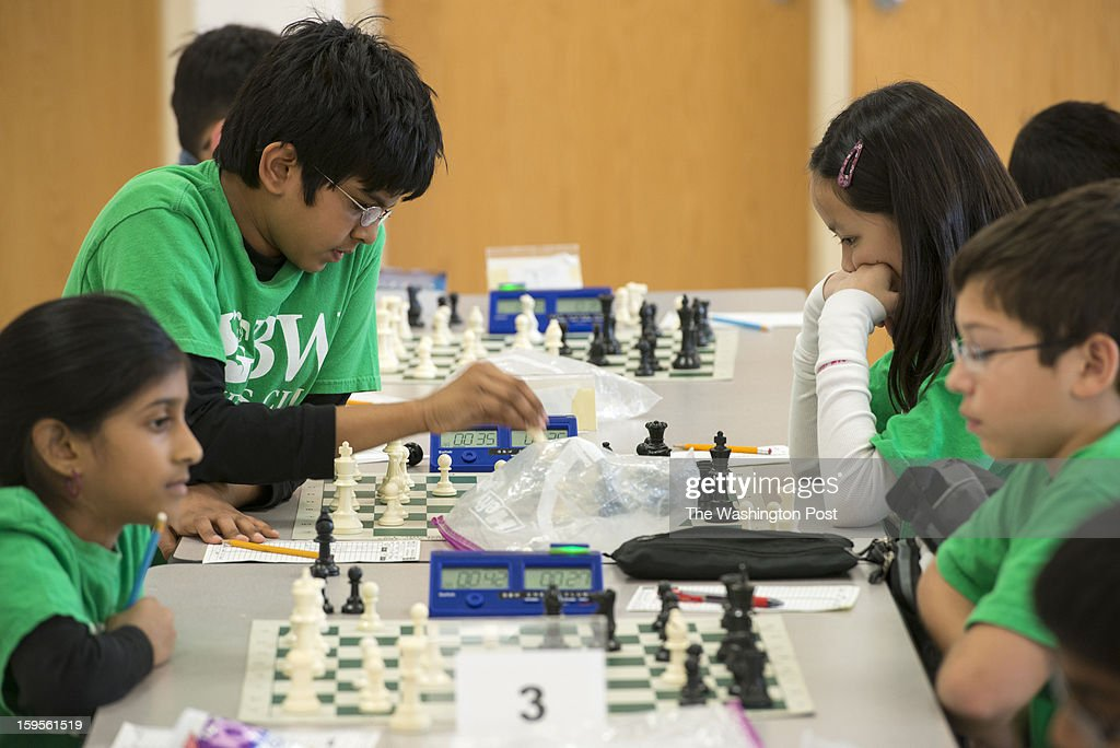 The Greenbrier West Elementary School chess team gathers in the school cafeteria to play against each other at Greenbriar West Elementary School in Chantilly, Virginia on January 07, 2013. At the top left and right, Fifth graders Revanth Vejju and Vivian Cao-Dao helped their chess team win at the K-12 national chess championships in Orlando, Florida.
