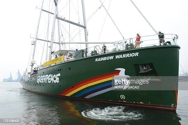 The Greenpeace flagship Rainbow Warrior repositions at Jakarta port after a visit by Indonesian President Susilo Bambang Yudhoyono on June 7 2013 The...
