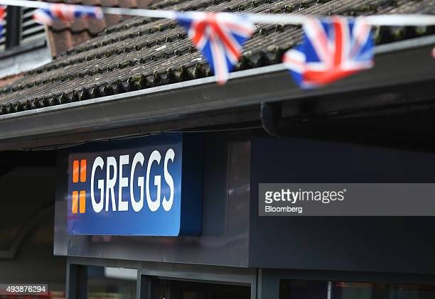 The Greggs logo sits on a sign above the entrance to a Greggs Plc sandwich chain outlet in Caterham UK on Thursday Oct 22 2015 Samestore sales at...