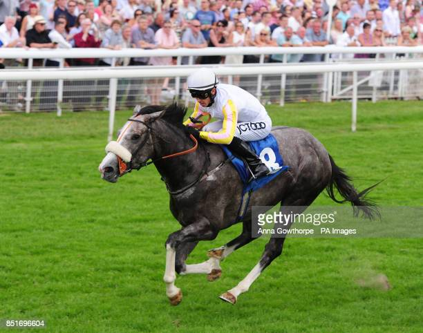 The Grey Gatsby ridden by Graham Lee wins the John Smith's Median Auction Stakes during the 2013 John Smith's Cup Meeting at York Racecourse York