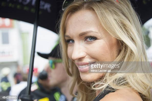 The grid girl smiles on the grid during the MotoGP race during the MotoGp of Czech Republic Race at Brno Circuit on August 16 2015 in Brno Czech...