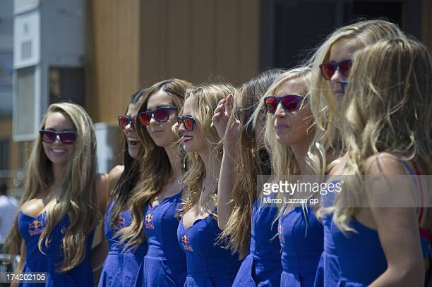 The grid girls pose in paddock before the MotoGP race during the MotoGp Red Bull US Grand Prix Race at Mazda Raceway Laguna Seca on July 21 2013 in...
