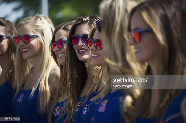 The grid girls pose in paddock during the MotoGp Red Bull US Indianapolis Grand Prix Qualifying at Indianapolis Motor Speedway on August 17 2013 in...