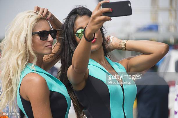The grid girls pose in pit during the MotoGp of Czech Republic Qualifying at Brno Circuit on August 15 2015 in Brno Czech Republic