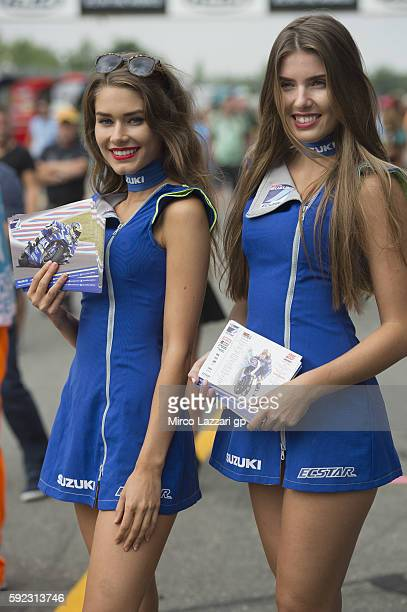 The grid girls smile in paddock during the MotoGp of Czech Republic Qualifying at Brno Circuit on August 20 2016 in Brno Czech Republic
