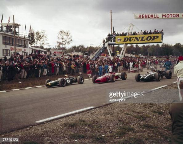 The grid rolls off on a parade lap before the start of the 1966 US Grand Prix at Watkins Glen NY Jack Brabham on left in his BrabhamRepco Lorenzo...