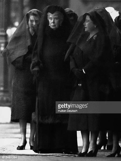 The griefstricken family of the late King George VI of England at his funeral Shown are Princess Elizabeth the next monarch Queen Mary the Queen...