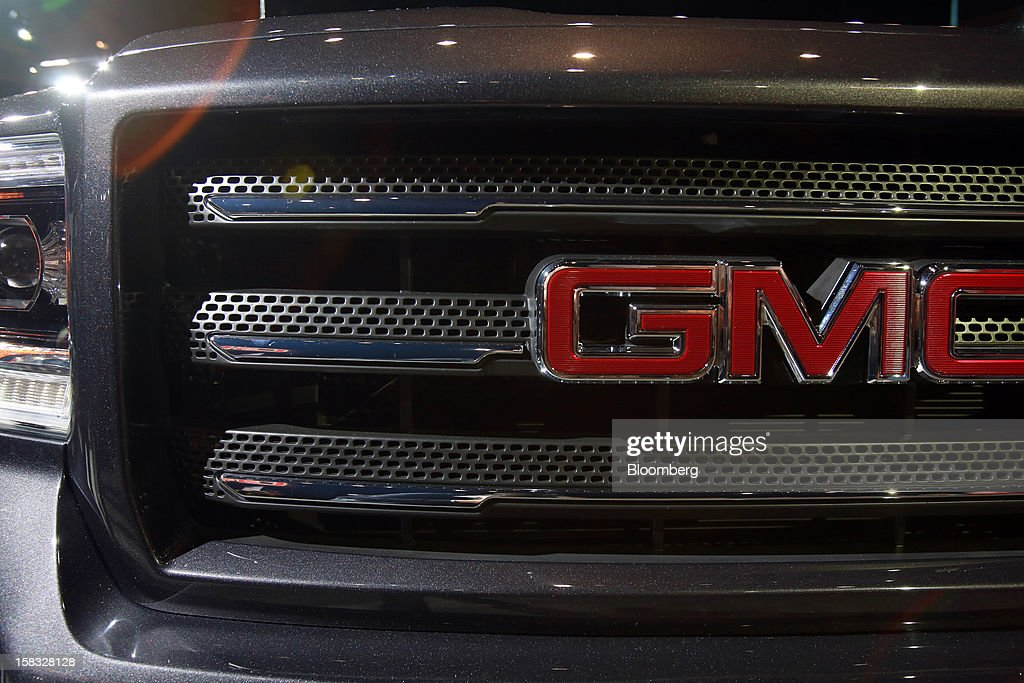 The grill of a General Motors Co. (GM) 2014 GMC Sierra pickup truck is displayed during the vehicle's unveiling at an event in Pontiac, Michigan, U.S., on Thursday, Dec. 13, 2012. Even with the recent cloud of high existing truck inventories, the new Chevrolet Silverado and GMC Sierra pickups hold the promise of giving GM's investors, the U.S. government included, a long awaited boost. Photographer: Fabrizio Costantini/Bloomberg via Getty Images