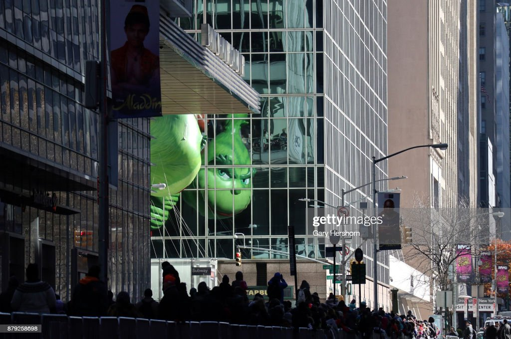 The Grinch balloon floats down 6th Avenue as it crosses 42nd Street during the annual Thanksgiving Day Parade on November 23, 2017 in New York City. The Macy's Thanksgiving Day parade is the largest parade in the world and has been held since 1924.