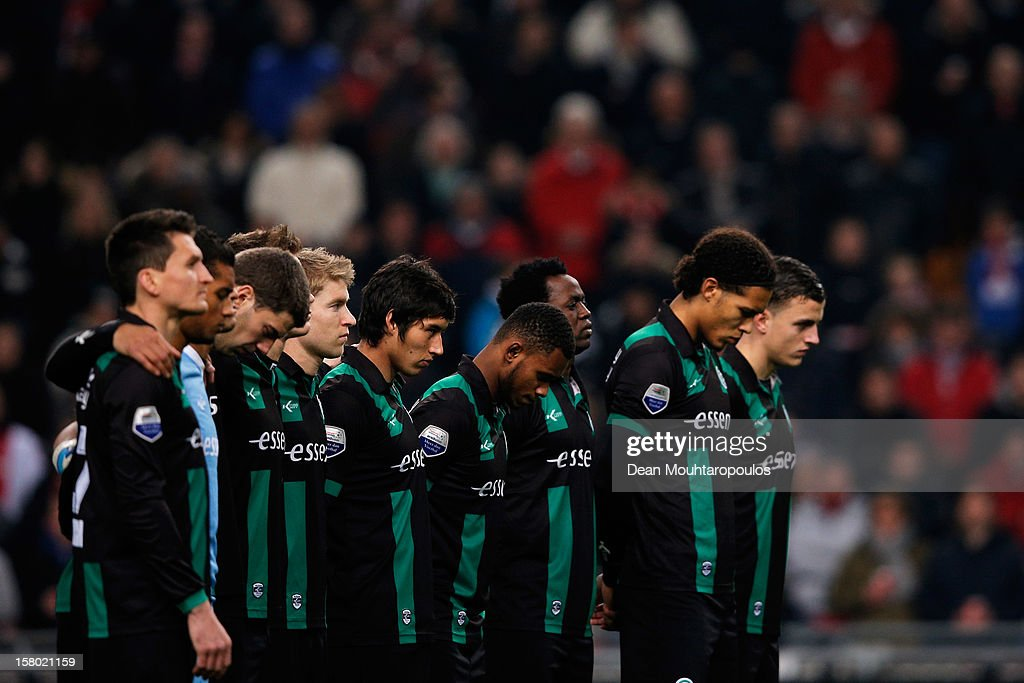 The Groningen players stand for the minute silence prior to the Eredivisie match between Ajax Amsterdam and FC Groningen at Amsterdam Arena on December 8, 2012 in Amsterdam, Netherlands. The minute silence was for Richard Nieuwenhuizen, 41, who was attacked while officiating for the Buitenboys team in an under-17 match in Almere last Sunday. He died the following day.