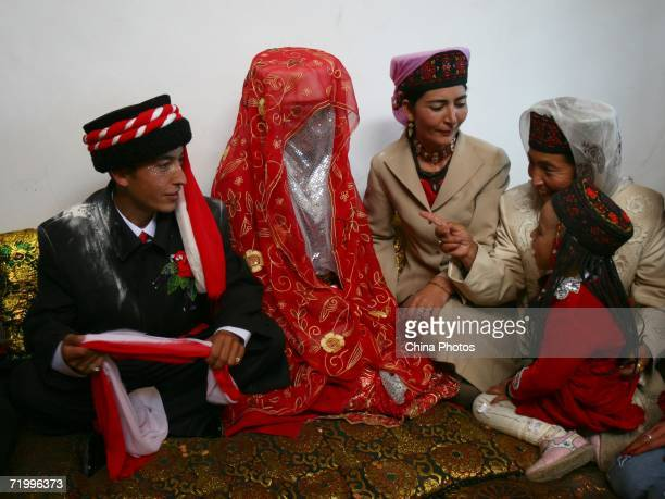 The groom and bride talk with guests during a wedding ceremony of Tajik ethnic minority group on September 24 2006 in Taxkorgan County of Kashi...