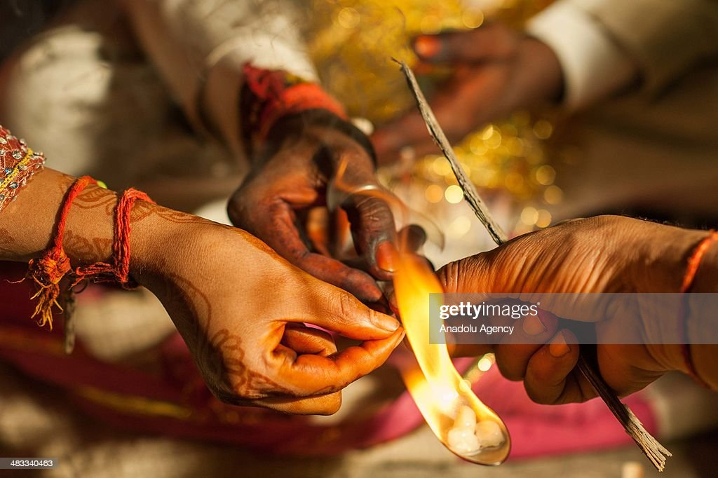 The groom incenses which is believed to bring plentifulness, during his wedding ceremony in the outskirts of New Delhi, India on March 13, 2014. Usually around 500 to 1000 guests wearing traditional clothes, attend the traditional wedding ceremony. The ceremony including traditional foods, music and dance, may differ from religion, culture and region.