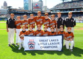 The Grosse Pointe WoodsShores Little League Team pose for a photo prior to the game between the Detroit Tigers and the Chicago White Sox at Comerica...