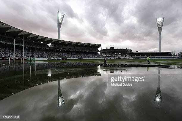 The ground is seen under water after a storm passed through before the round two AFL NAB Challenge Cup match between the Western Bulldogs and the St...