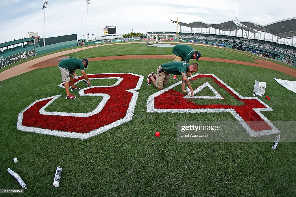 The grounds crew at jetBlue Park paint the number 34 to honor David Ortiz on the sidelines after the game between the Boston Red Sox the Philadelphia Phillies on March 27, 2016 in Fort Myers, Florida. Ortiz will be honored tomorrow when he takes the field for his last spring training game in Fort Myers. The Red Sox defeated the Phillies 5-1.