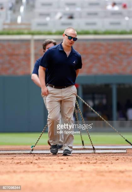 The grounds crew drags the field during the MLB game between the Atlanta Braves and the Miami Marlins on August 6 2017 at SunTrust Park in Atlanta GA...