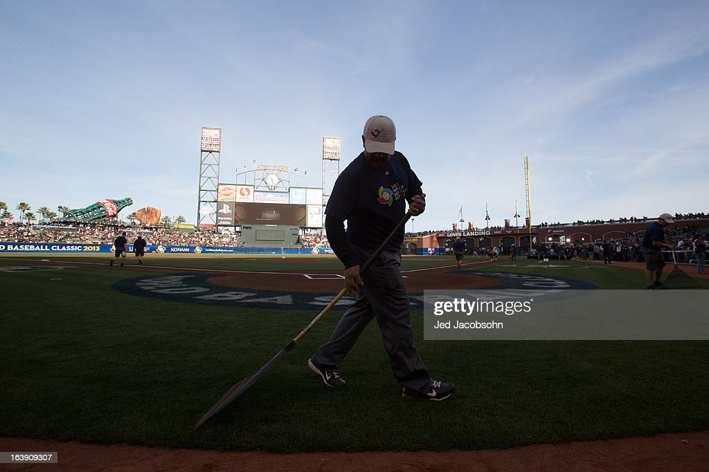 The grounds crew gets the field ready before the semi-final game between Team Puerto Rico and Team Japan in the championship round of the 2013 World Baseball Classic on Sunday, March 17, 2013 at AT&T Park in San Francisco, California.
