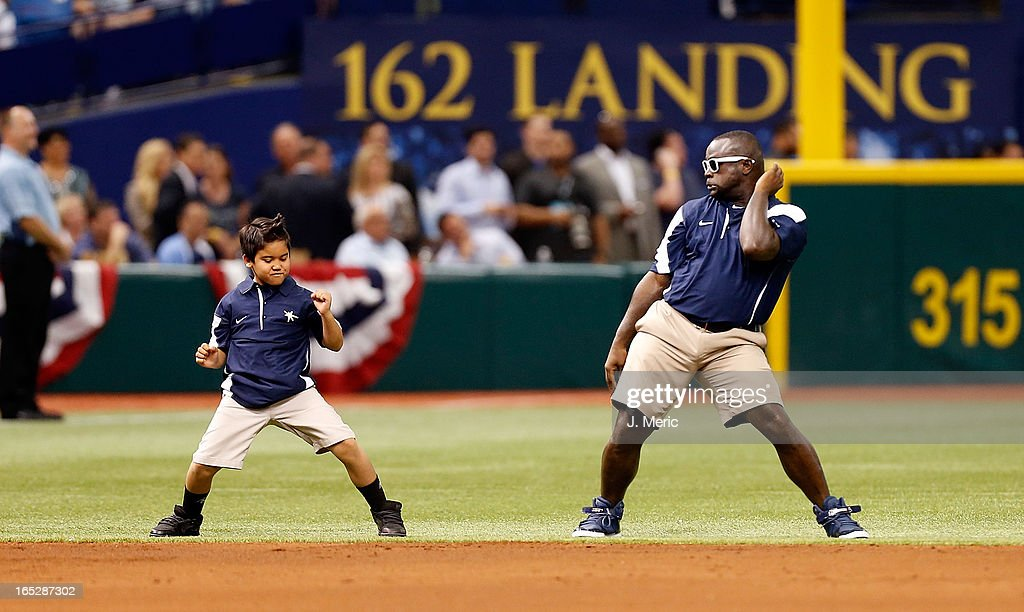 The grounds crew of the Tampa Bay Rays dances during the Opening Day game against the Baltimore Orioles at Tropicana Field on April 2, 2013 in St. Petersburg, Florida.