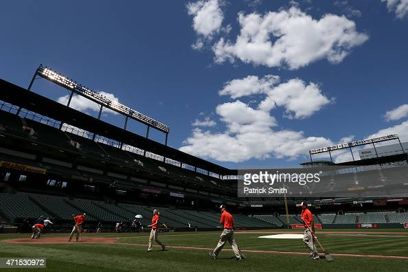 The grounds crew prepares the field before the Baltimore Orioles play the Chicago White Sox at an empty Oriole Park at Camden Yards on April 29 2015...