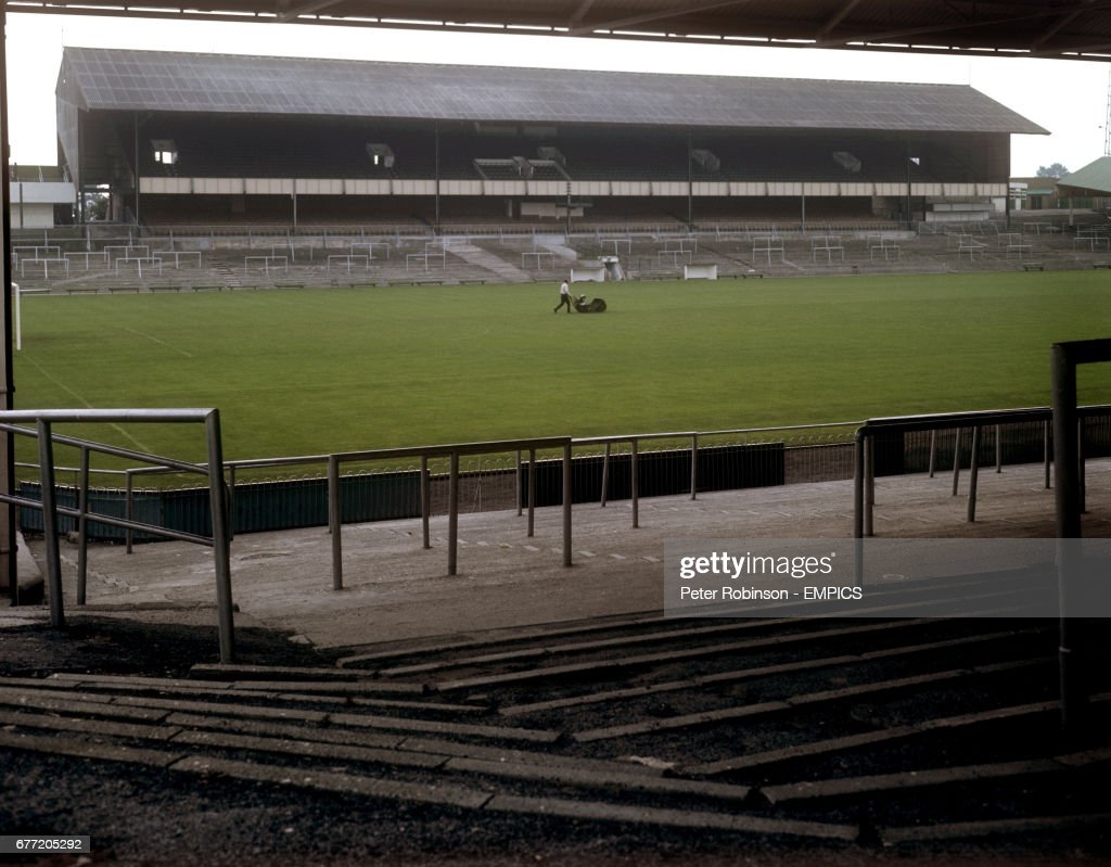 The Groundsman Mows Grass On Pitch At Home Park In Front Of Grandstand