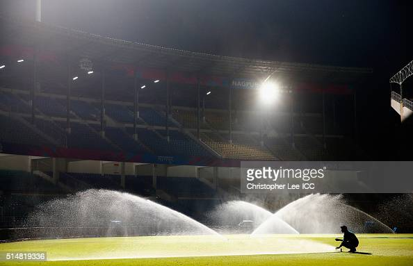 The groundsman waters the pitch at the end of the day during the ICC Twenty20 World Cup Round 1 Group B match between Hong Kong and Afghanistan at...