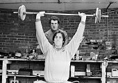 The groundsman's workshop provides a makeshift weights room with Aston Villa defender Chris Nicholl working out watched by John Burridge as bad...