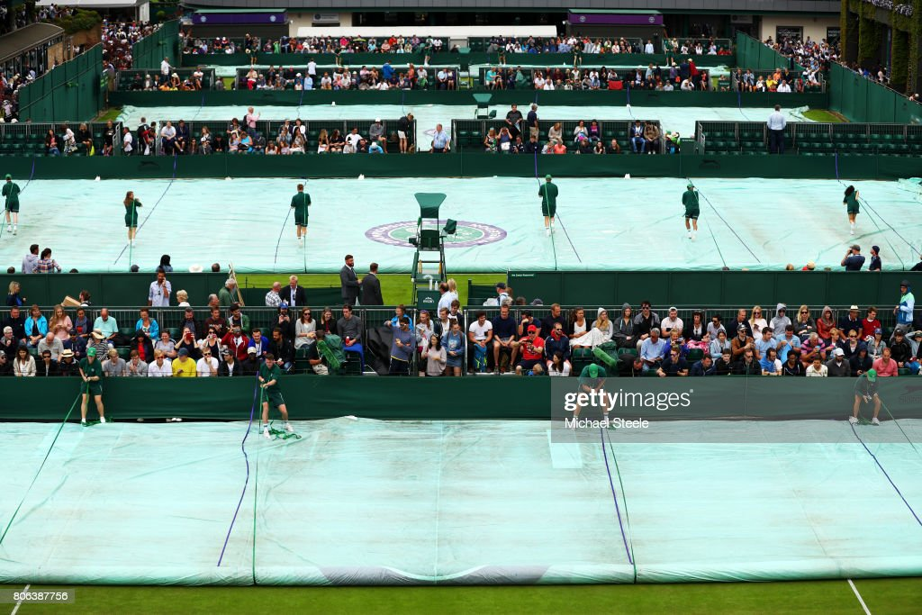 The groundstaff remove the covers off courts after a stop due to rain on day one of the Wimbledon Lawn Tennis Championships at the All England Lawn Tennis and Croquet Club on July 3, 2017 in London, England.