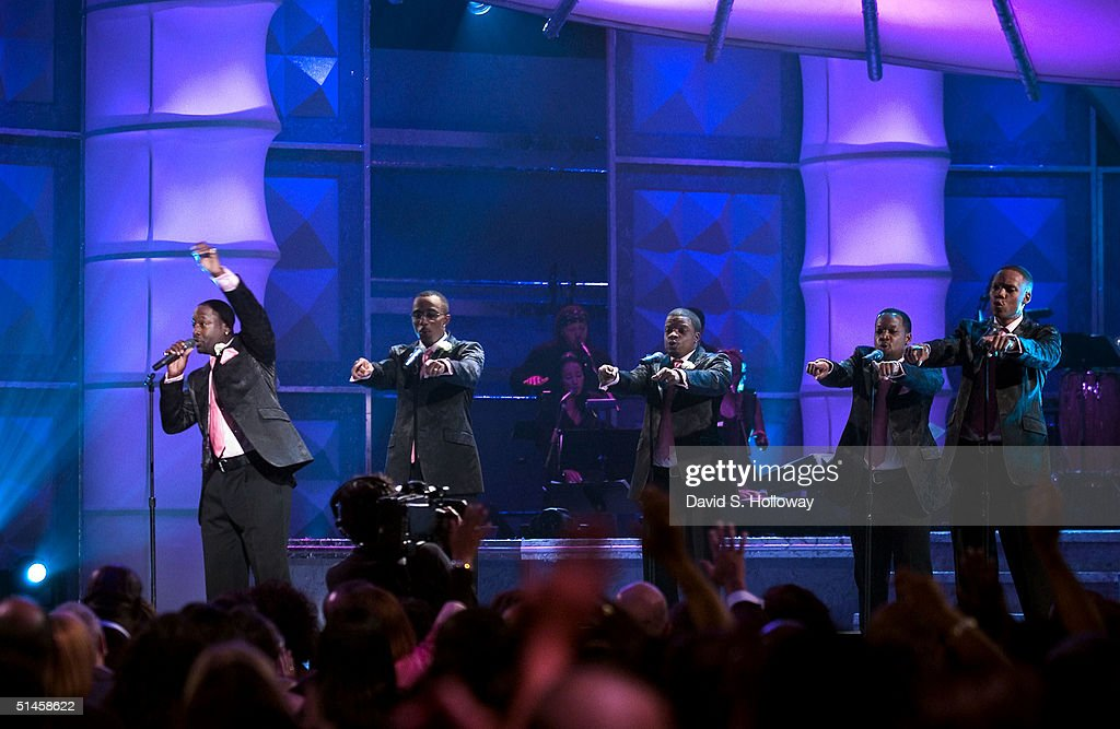 The group New Edition performs at Black Entertainment Television's 10th Anniversary Walk of Fame celebration honoring Smokey Robinson on October 9, 2004 in Washington, DC.