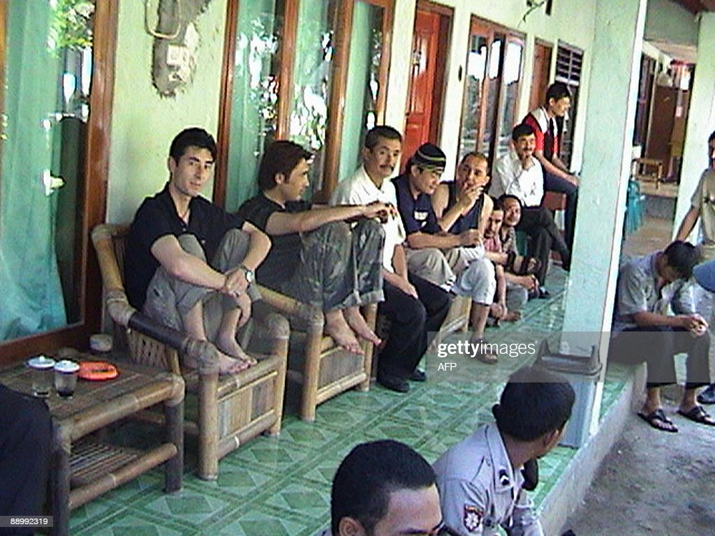 The group of 15 Afghans rescued by Indonesian fisherman from their damaged boat are held at a lodging house guarded by police in Sumbawa island on July 12, 2009. The group was part of the 74 asylum seekers, who have been missing since July 8, in treacherous waters near Komodo island en route to Australia, police said. The Indonesian navy had been searching for the boat after being told it had gone missing by Australian police. Indonesia is a transit route for migrants from the Middle East and Asia seeking to travel to Australia in rickety boats with the help of people smugglers. AFP PHOTO