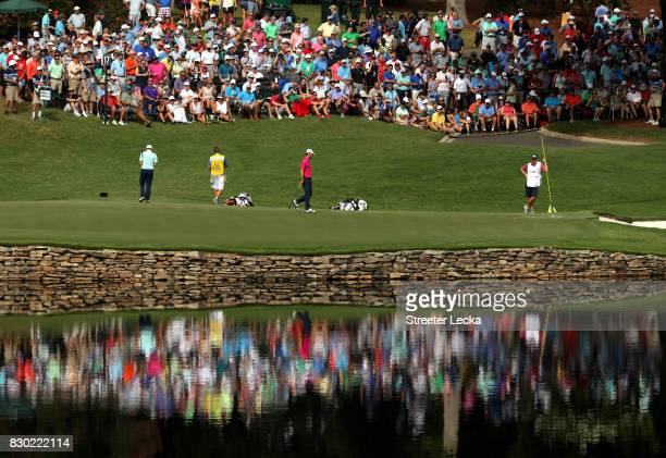 The group of Billy Horschel of the United States Matthew Fitzpatrick of England and Si Woo Kim of South Korea on the 17th green during the second...