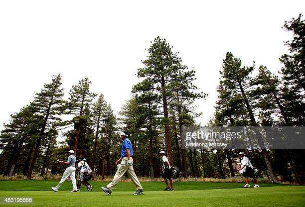 The group of Charlie Wi Ryo Ishikawa and Tim Wilkinson walk off of the 13th tee during the first round of the Barracuda Championship at the Montreux...