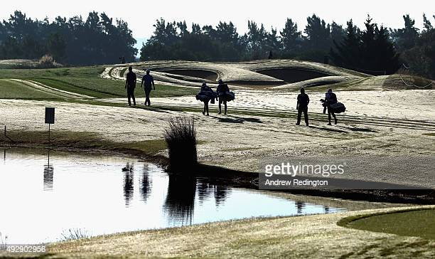 The group of Chris Wood of England Bernd Wiesberger of Austria and Alexander Levy of France walk towards the 12th fairway during the second round of...