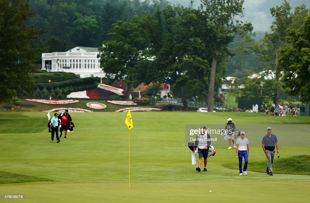 The group of Jonathan Byrd Michael Putnam and Scott Langley walk up the first fairway during the first round of the Greenbrier Classic at the Old...