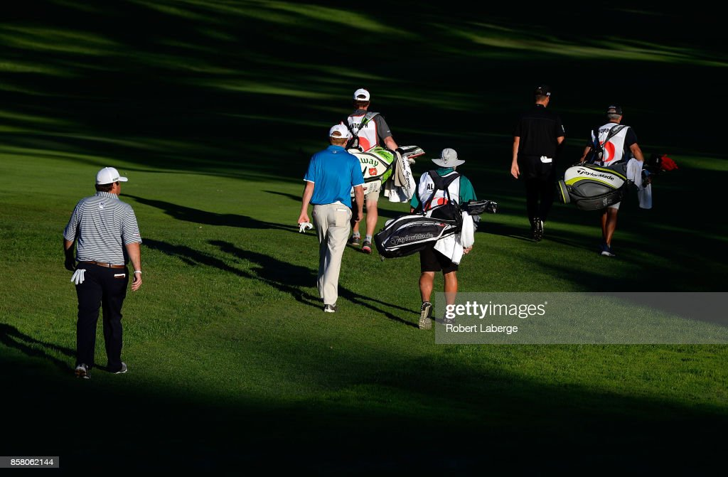 The group of Jonathan Randolph, Kyle Thompson and Steve Allan walk down the fairway during the first round of the Safeway Open at the North Course of the Silverado Resort and Spa on October 5, 2017 in Napa, California.