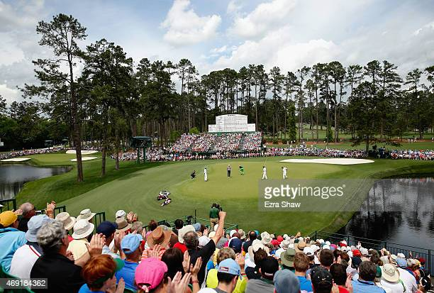 The group of Jordan Spieth of the United States Billy Horschel of the United States and Henrik Stenson of Sweden play the 15th green during the...