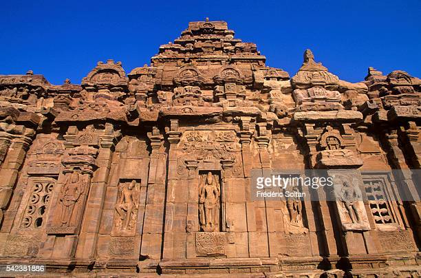 The group of monuments of Pattadakal built in the 8th century is a famous example of the vesara style of Hindu temple architecture | Location...
