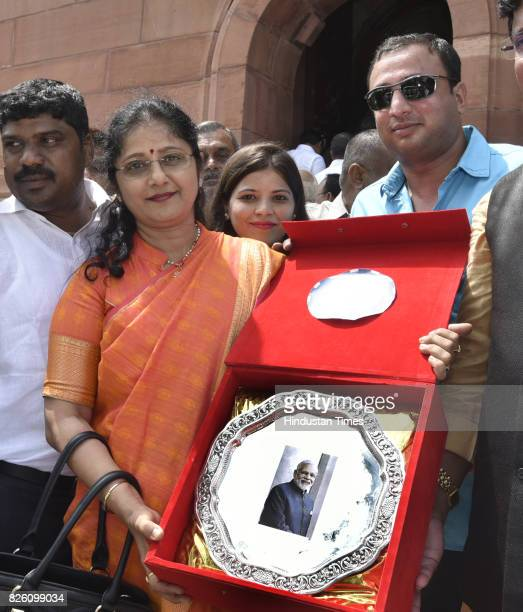 The group of people going to present the memento to PM Narendra Modi who came to witness the proceedings of the Parliament of the ongoing Monsoon...