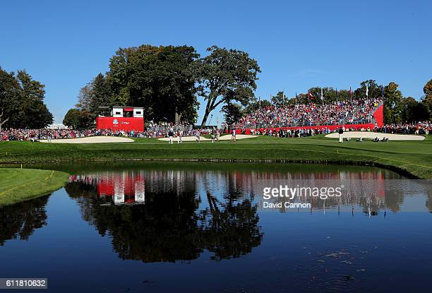 The group of Rory McIlroy and Thomas Pieters of Europe and Rickie Fowler and Phil Mickelson of the United States is seen on the 16th green during...