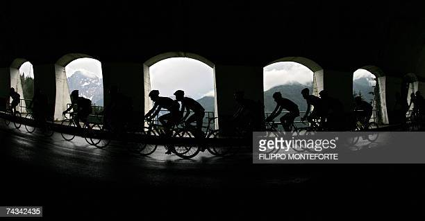 The group of the escapers ride under a tunnel during the fifteenth stage of the Giro d'Italia cycling race 184km race from Trento to Tre Cime di...