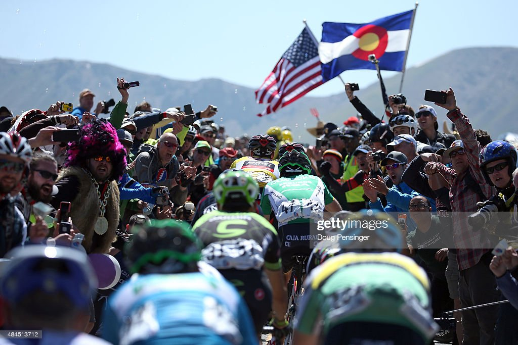 The group of the overall race leader <a gi-track='captionPersonalityLinkClicked' href=/galleries/search?phrase=Brent+Bookwalter&family=editorial&specificpeople=6931494 ng-click='$event.stopPropagation()'>Brent Bookwalter</a> of United States riding for BMC Racing in the yellow jersey makes their way through the fans on the summit of Independence Pass during stage three of the 2015 USA Pro Challenge from Copper Mountain to Aspen on August 19, 2015 in Aspen, Colorado.