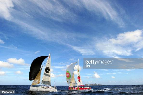 The 'Groupe Bel' and 'MemoiresStBarthcom' monohulls are seen upon their arrival at the end of the transat AG2R La Mondiale sailing race between...