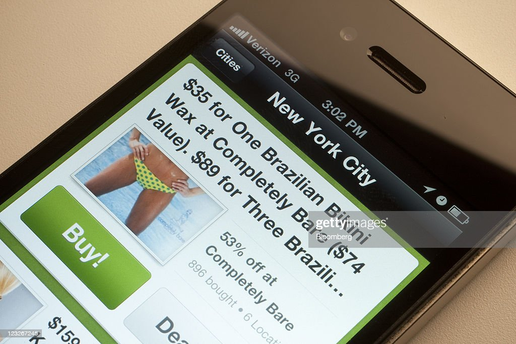 The Groupon Inc app is displayed on a mobile device for a photograph in New York US on Wednesday Aug 31 2011 Photographer Scott Eells/Bloomberg via...