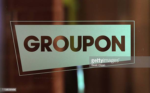 The Groupon logo is displayed in the company's international headquarters on June 10 2011 in Chicago Illinois Groupon a local ecommerce marketplace...