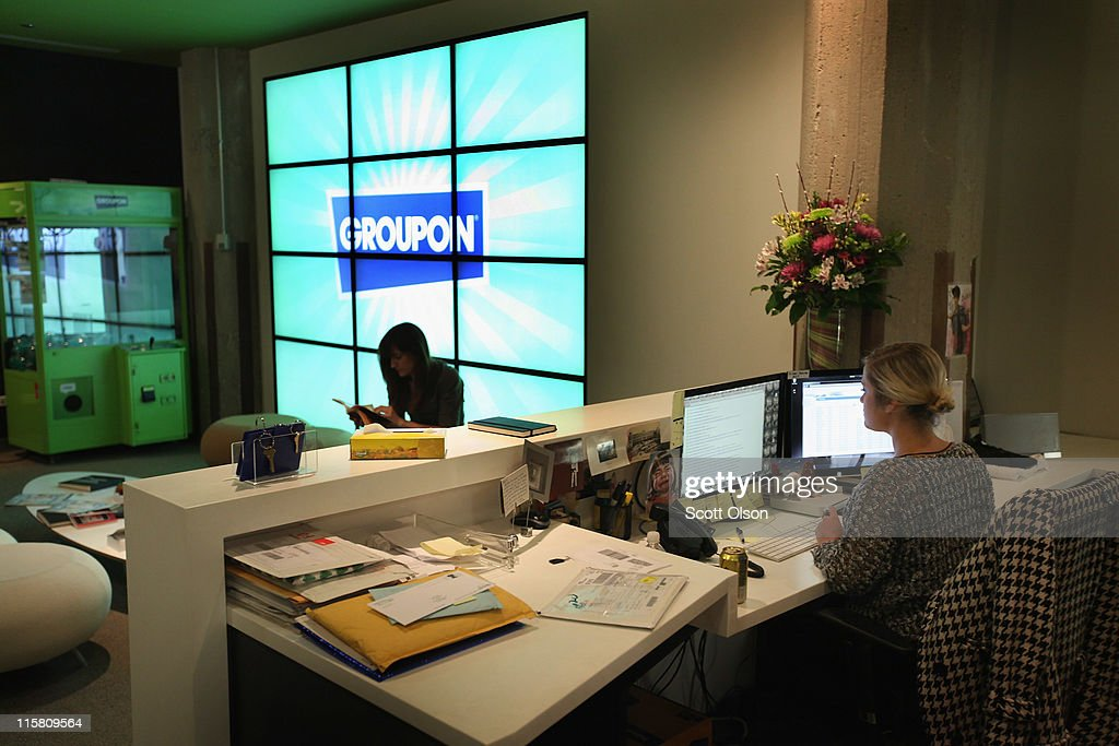 The Groupon logo is displayed in the lobby of the company's international headquarters on June 10 2011 in Chicago Illinois Groupon a local ecommerce...